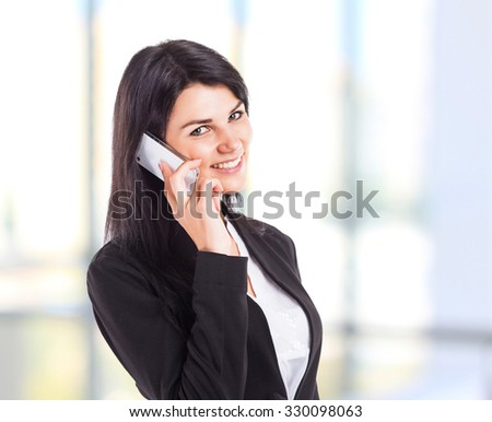 Young, attractive, successful business woman, talking on the phone. - stock photo