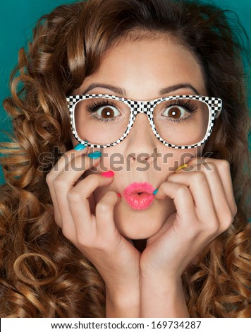 Young attractive surprised woman wearing glasses - stock photo