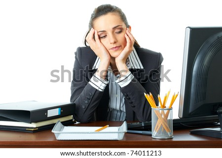 young attractive tired, overworked and exhausted female office worker in grey suit, isolated on white background - stock photo