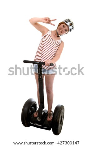 young attractive tourist woman wearing safety helmet doing peace hands sign  smiling happy riding electrical segway having fun driving isolated on white background in ecological transport concept - stock photo
