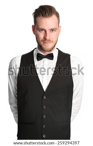 Young attractive waiter wearing a white shirt and black vest, serving. White background. - stock photo