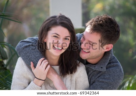 Young attractive white couple embracing each other - stock photo