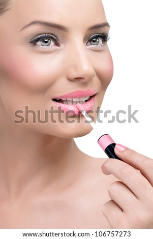 Young attractive woman applauding glossy on her lips - stock photo