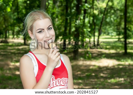 young attractive woman eating ice cream - stock photo
