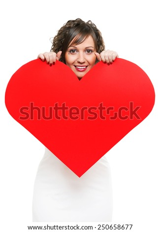 Young attractive woman holding red paper heart like a valentine card - stock photo