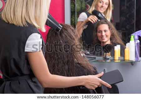 young attractive woman in beauty salon - stock photo