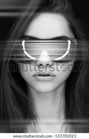 Young attractive woman in sunglasses - stock photo