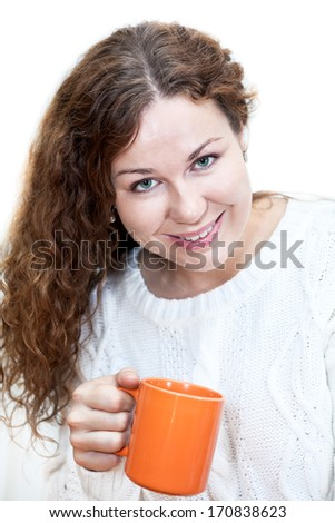 Young attractive woman in white sweater with a cup in hand, isolated on white background - stock photo