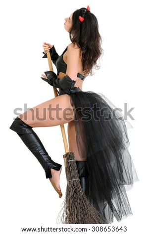 young attractive woman in witch costume with broom in the halloween party isolated on white - stock photo