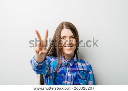 young attractive  woman indicating the number two - stock photo