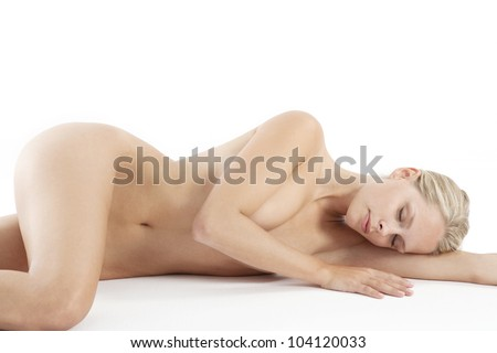 Young attractive woman laying naked on a white background, sleeping. - stock photo