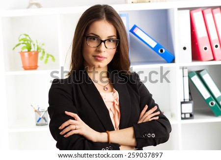 Young attractive woman legal adviser waiting clients in the office. Concept of authority and expertise.  - stock photo