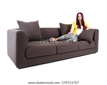 Young attractive woman on sitting on sofa - stock photo