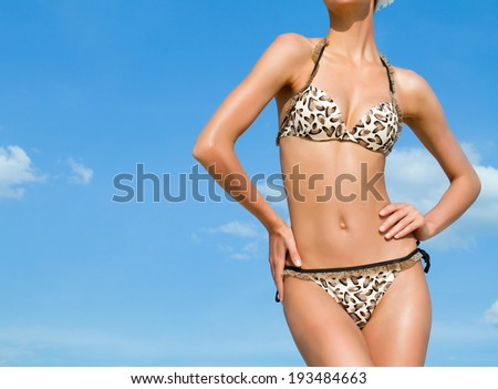 young attractive woman on the beach - stock photo
