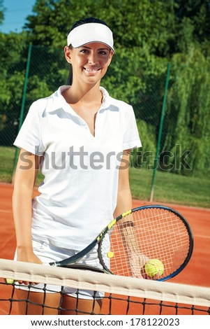 Young attractive woman playing tennis  - stock photo