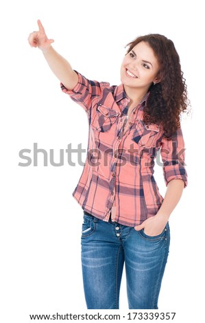 Young attractive woman touching an imaginary screen with her finger, isolated on white background - stock photo