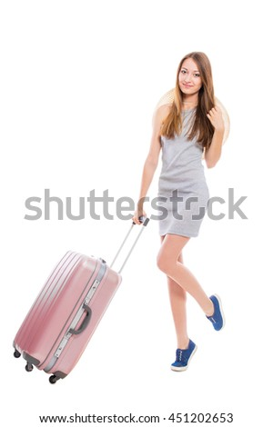 Young attractive woman with a suitcase isolated on white background. Recreation and tourism concept. - stock photo
