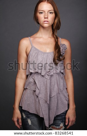 Young attractive woman with gold blond curly hair. - stock photo