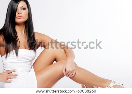 Young attractive woman with long black hair. - stock photo