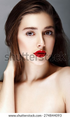 Young attractive woman with red lips. In studio - stock photo