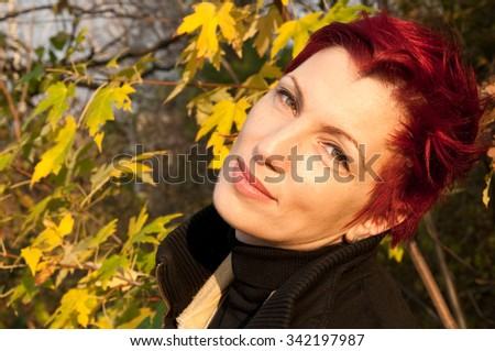 young attractive woman with short red hair and green eyes  - stock photo