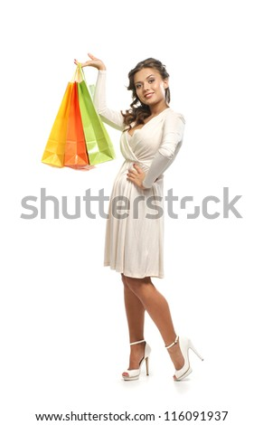 Young attractive woman with the shopping bags isolated on white - stock photo