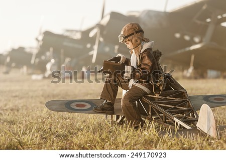 Young Aviator parked aircraft at the airport autumn day - stock photo
