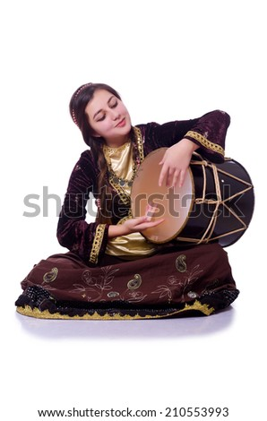 Young azeri woman playing traditional drum nagara - stock photo