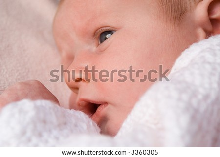 young baby(focus on eyes) - stock photo