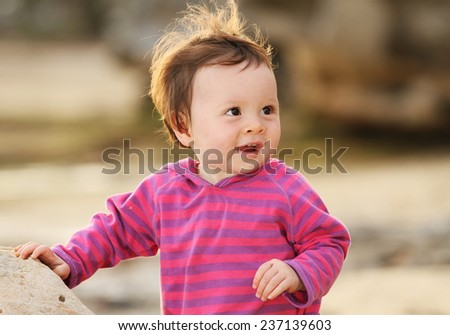 Young Baby Girl Laughing Outside - stock photo