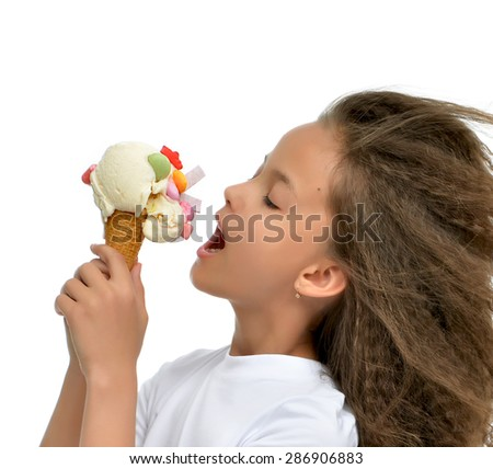 Young baby girl ready for eating red vanilla ice cream in waffles cone with chewing gums isolated on a white background - stock photo