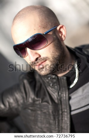 Young bald man with sunglasses - stock photo