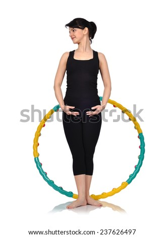 Young balet dancer woman with color hula hoop - stock photo