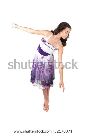 Young ballerina in pretty purple dress - stock photo