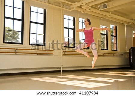 Young ballerina practicing in a dance studio. - stock photo