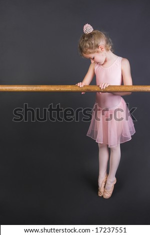 Young ballet dancer wearing an apricot tutu - stock photo