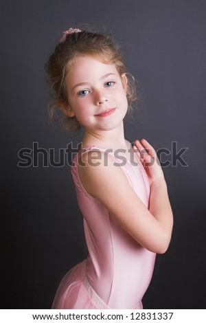 Young ballet dancer wearing an leotard and skirt - stock photo