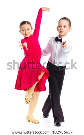 Young ballroom dancers in formal costumes posing. Isolated on white background - stock photo