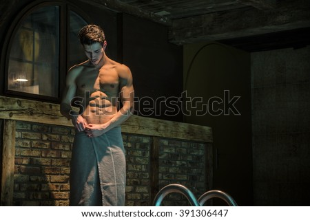 Young Bare Muscular Young Man at Swimming Pool  - stock photo