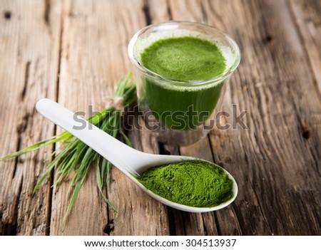 Young barley and chlorella spirulina. - stock photo