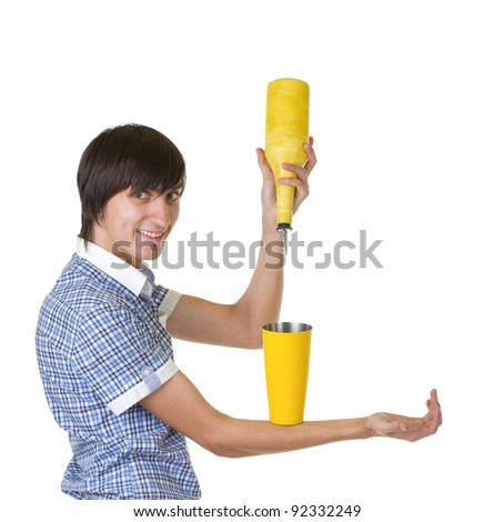 Young bartender does a trick with a shaker on white background - stock photo