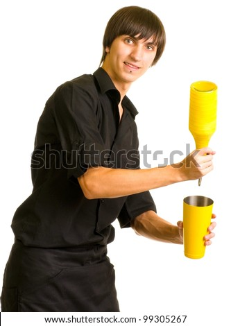 Young bartender with a shaker and bottle on white background - stock photo