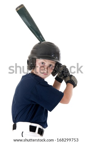 Young baseball player focused batting left handed - stock photo
