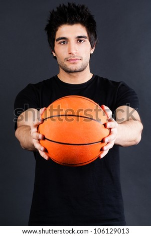young basket ball player holding basket ball - stock photo