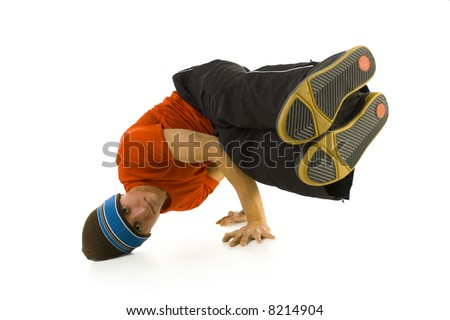 Young bboy holding up on hands and head. Holding legs in air. Looking at camera. Isolated on white in studio. Front view, whole body - stock photo