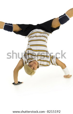 Young bboy standing on hands. Holding legs in air. Looking at camera. Front view, white background - stock photo