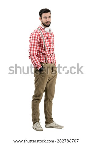 Young bearded dj in retro clothes looking at camera. Full body length portrait isolated over white background.  - stock photo