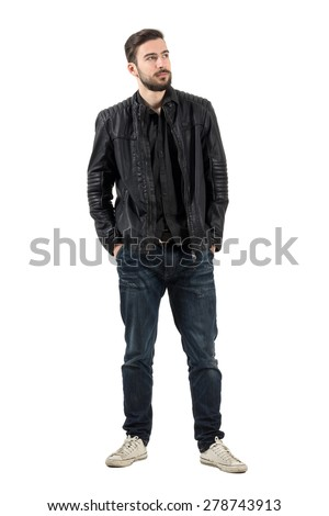 Young bearded fashion model looking up with hands in pockets. Full body length portrait isolated over white background.  - stock photo