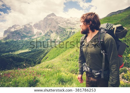 Young Bearded Man Traveler with backpack mountaineering Travel Lifestyle concept mountains on background Summer adventure vacations outdoor - stock photo