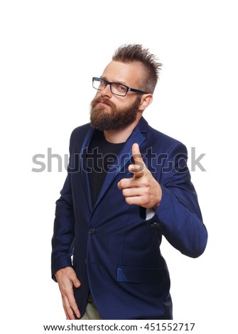 Young bearded man wearing glasses point finger at camera, isolated at white background. Portrait of a confident guy in stylish eyeglasses. Boy style, trendy hipster with cool hairstyle in blue suit. - stock photo